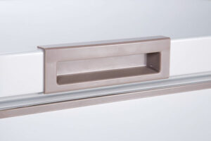 Close up of chest freezer lid handle